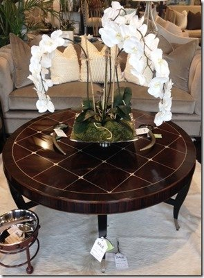 round cocktail table with silver detail
