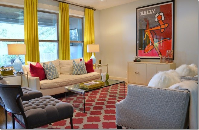 After, family room with colorful pattern rug and citrine drapes