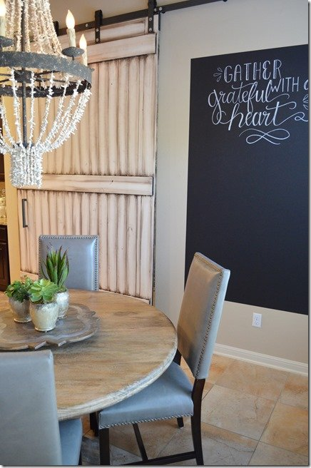 after breakfast room with grey leather dining chairs