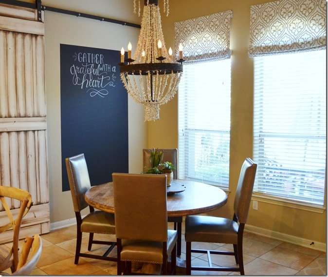 breakfast nook after with shell light fixture barn door and chalkboard wall