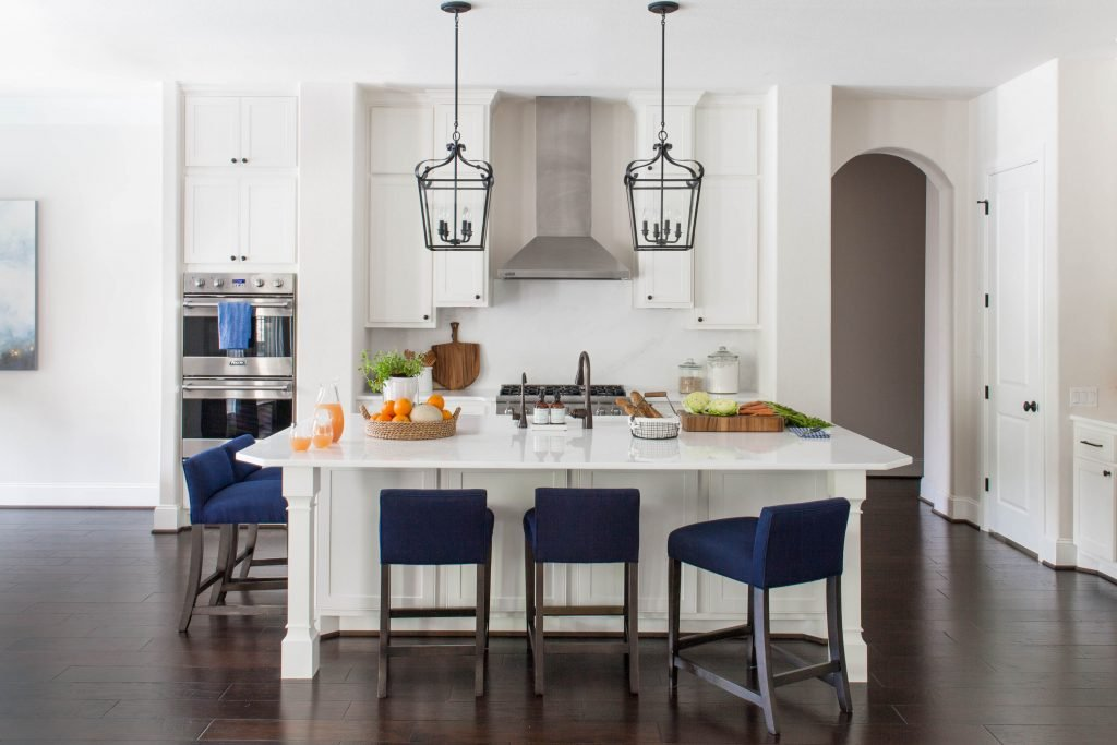 ... the perfect place for this family to gather for homework, snacks and  just hanging out. The low back counter stools keep the view into the kitchen  open.