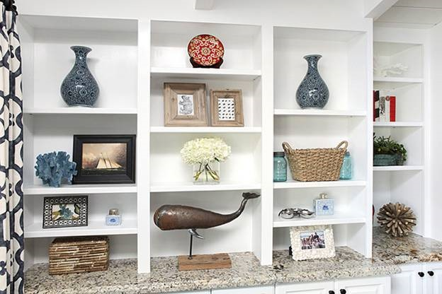 the coral provides a nice textural palette within each shelf i also appreciate the way they took scale into consideration each piece fits very well within - How To Decorate Bookshelves