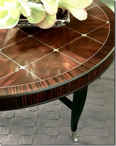 round cocktail table with rosewood top and black legs