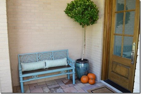 bench and tree by front door