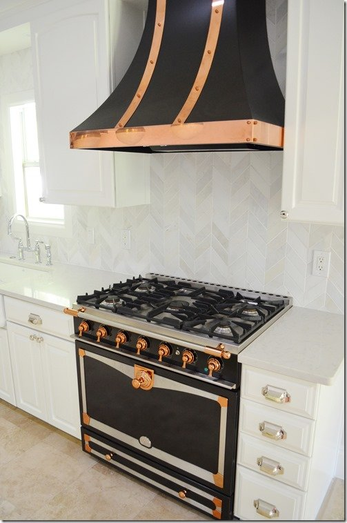 black and copper la cornue stove and hood
